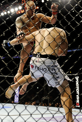 """Hapa"" attempts a flying knee in his bout against Chad Griggs"