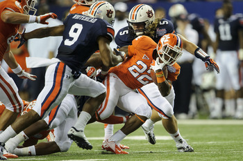 Jermaine Whitehead (No. 9) and Jake Holland (No. 5) make a stop against Clemson Saturday.