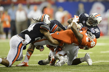 Ryan Smith (No. 24) and Angelo Blackson (No. 98) make a stop against Clemson in the on Saturday.