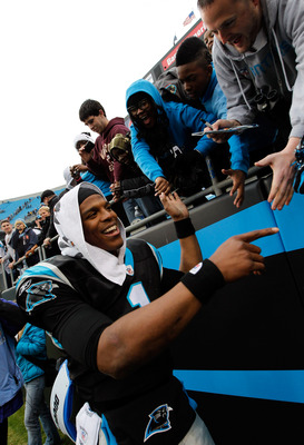 Being on the right side of the scoreboard when the game is over makes Newton a happy guy
