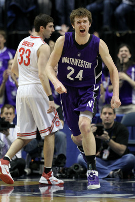 INDIANAPOLIS, IN - MARCH 11:  John Shurna #24 of the Northwestern Wildcats reacts against the Ohio State Buckeyes during the quarterfinals of the 2011 Big Ten Men's Basketball Tournament at Conseco Fieldhouse on March 11, 2011 in Indianapolis, Indiana.  (