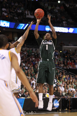 TAMPA, FL - MARCH 17:  Kalin Lucas #1 of the Michigan State Spartans attempts a shot against the UCLA Bruins during the second round of the 2011 NCAA men's basketball tournament at St. Pete Times Forum on March 17, 2011 in Tampa, Florida.  (Photo by Mike