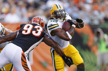 Newest Green Bay running back Cedric Benson avoiding tackles in his Aug. 30 preseason debut in Cincinnati.