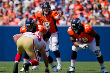 Denver Broncos quarterback Peyton Manning calling out defenses at the line of their Aug. 26 preseason game in Denver.