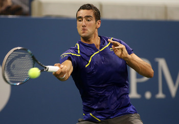 NEW YORK, NY - AUGUST 27:  Marin Cilic of Croatia returns a shot during his men's singles first round match against Marinko Matosevic of Australia on Day One of the 2012 US Open at USTA Billie Jean King National Tennis Center on August 27, 2012 in the Flu