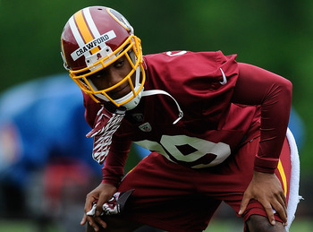 ASHBURN, VA - MAY 06: Richard Crawford #39 of the Washington Redskins stretches during the Washington Redskins rookie minicamp on May 6, 2012 in Ashburn, Virginia. (Photo by Patrick McDermott/Getty Images)