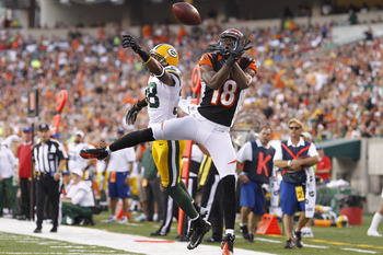 CINCINNATI, OH - AUGUST 23: Tramon Williams #38 of the Green Bay Packers defends a pass in the end zone against A.J. Green #18 of the Cincinnati Bengals during a preseason NFL game at Paul Brown Stadium on August 23, 2012 in Cincinnati, Ohio. (Photo by Jo