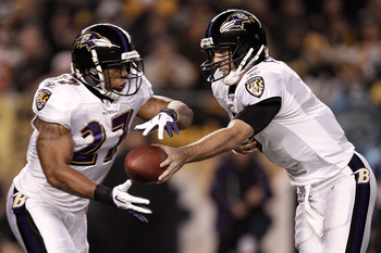PITTSBURGH, PA - NOVEMBER 06:  Joe Flacco #5 of the Baltimore Ravens hands the ball off to teammate Ray Rice #27 against the Pittsburgh Steelers during the game on November 6, 2011 at Heinz Field in Pittsburgh, Pennsylvania.  (Photo by Jared Wickerham/Get