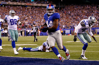 EAST RUTHERFORD, NJ - SEPTEMBER 05:  running back Ahmad Bradshaw #44 of the New York Giants scores a touchdown in the third quarter past free safety Gerald Sensabaugh #43 of the Dallas Cowboys during the 2012 NFL season opener at MetLife Stadium on Septem
