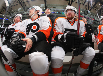 UNIONDALE, NY - MARCH 15:  (L-R) Danny Briere #48 and Jakub Voracek #93 of the Philadelphia Flyers watch from the bench during the game against the New York Islanders at the Nassau Veterans Memorial Coliseum on March 15, 2012 in Uniondale, New York.  The