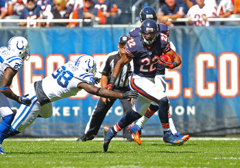 Mathis (98) reaches for Matt Forte.