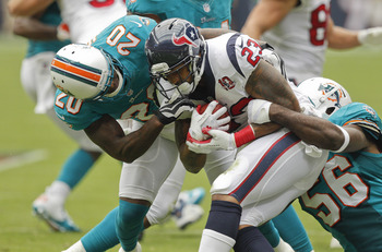 Arian Foster ran over, around and through the Dolphins defense.
