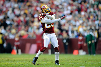 LANDOVER, MD - DECEMBER 04:   DeAngelo Hall #23 of the Washington Redskins reacts after  Nick Folk #2 of the New York Jets missed a 40 yard field goal in the third quarter at FedExField on December 4, 2011 in Landover, Maryland.  (Photo by Patrick McDermo