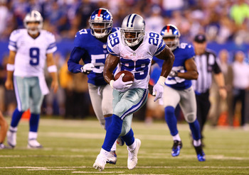 DeMarco Murray runs away from the Giants defense.