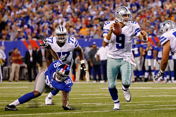 Tony Romo scrambles out of the pocket.