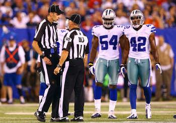 Replacement officials discuss call during Cowboys vs Giants game.