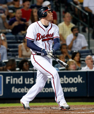 ATLANTA, GA - SEPTEMBER 12:  Freddie Freeman #5 of the Atlanta Braves hits a deep pop fly that scores Michael Bourn #24 in the fifth inning against the Florida Marlins at Turner Field on September 12, 2011 in Atlanta, Georgia.  (Photo by Kevin C. Cox/Gett