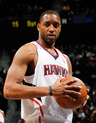ATLANTA, GA - DECEMBER 28:  Tracy McGrady #1 of the Atlanta Hawks walks on the court against the Washington Wizards at Philips Arena on December 28, 2011 in Atlanta, Georgia.  NOTE TO USER: User expressly acknowledges and agrees that, by downloading and o