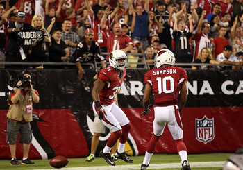 Justin Bethel (center) celebrates a blocked punt he returned for a touchdown with Isaiah Sampson.