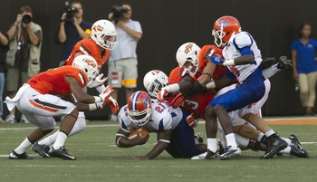 The guys getting pummelled by the Oklahoma State players are Savannah State's men.