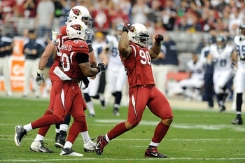 Darnell Dockett celebrates after a sack