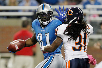 Calvin Johnson tells Brandon Meriweather to talk to his (freakishly large) hand.