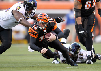 Andy Dalton sliding past Raven defenders
