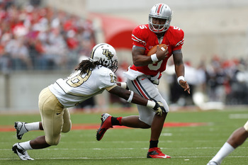 COLUMBUS, OH - SEPTEMBER 8:  Braxton Miller #5 of the Ohio State Buckeyes is tackled by Kemal Ishmael #18 of the Central Florida Knights on September 8, 2012 at Ohio Stadium in Columbus, Ohio. (Photo by Kirk Irwin/Getty Images)