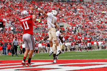 COLUMBUS, OH - SEPTEMBER 8:  Jordan Ozerities #10 of the Central Florida Knights is unable to block the ball as Jake Stoneburner #11 of the Ohio State Buckeyes makes the catch for a touchdown during the third quarter on September 8, 2012 at Ohio Stadium i