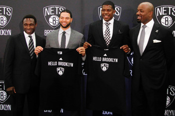 July 13, 2012; Brooklyn, NY, USA; Brooklyn Nets coach Avery Johnson , point guard Deron Williams , guard Joe Johnson and general manager Billy King pose for photos at a press conference at Brooklyn Borough Hall. Mandatory Credit: Debby Wong-US PRESSWIRE
