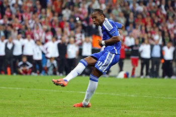 Drogba kicks the winning penalty against Bayern Munich in the Champions League final.