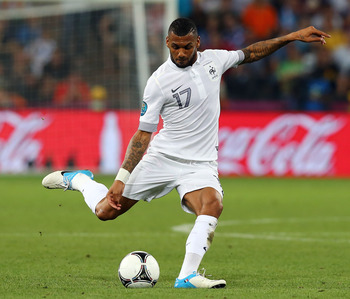 Yann M'vila kicking the ball.