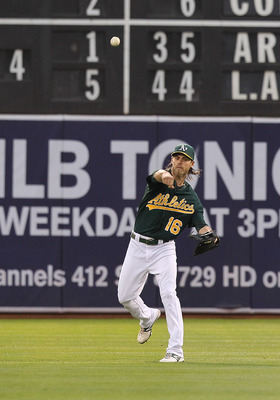 Josh Reddick throws the ball back into the infield