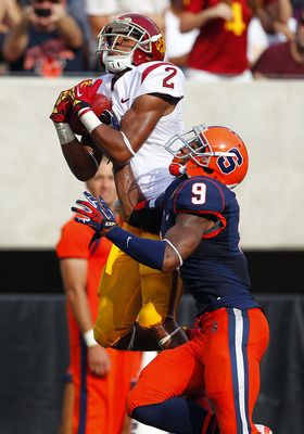 EAST RUTHERFORD, NJ - SEPTEMBER 8: Robert Woods #2 of the USC Trojans makes a catch near the end zone and scores a touchdown as Ri'Shard Anderson #9 of the Syracuse Orange defends in the first half during a game at MetLife Stadium on September 8, 2012 in