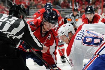 Lars Eller faces off against Nicklas Backstrom of the Washington Capitals.