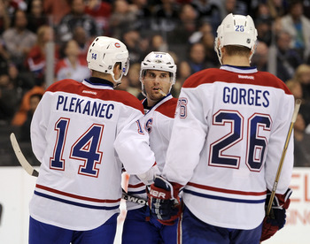 Brian Gionta, flanked by Tomas Plekanec and Josh Gorges.