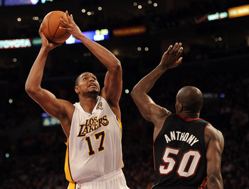 LOS ANGELES, CA - MARCH 04:  Andrew Bynum #17 of the Los Angeles Lakers takes a shot in front of Joel Anthony #50 of the Miami Heat at Staples Center on March 4, 2012 in Los Angeles, California.  NOTE TO USER: User expressly acknowledges and agrees that,