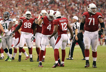 Kevin Kolb celebrates with Andre Roberts after the two connected on the game-winning touchdown.