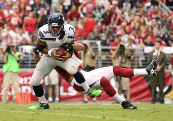 Paris Lenon sacks Russell Wilson in the first quarter.