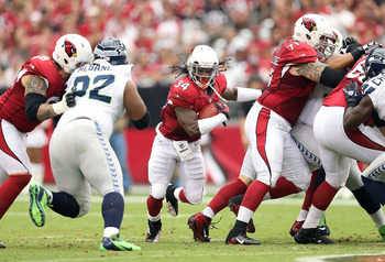 Ryan Williams (center) and the Cardinals need more offense on the ground.