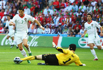 GENEVA - JUNE 11:  Cristiano Ronaldo (#7) of Portugal attempts to get past Petr Cech (#1) of Czech Republic during the UEFA EURO 2008 Group A match between Czech Republic and Portugal at Stade de Geneve on June 11, 2008 in Geneva, Switzerland.  (Photo by 