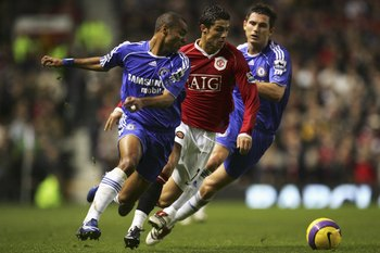 MANCHESTER, UNITED KINGDOM - NOVEMBER 26: Cristiano Ronaldo of Manchester United tries to evade the challenges of Ashley Cole (L) and Frank Lampard of Chelsea during the Barclays Premiership match between Manchester United and Chelsea at Old Trafford on N