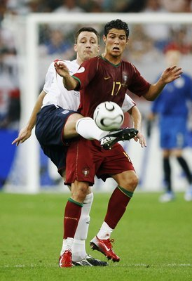 GELSENKIRCHEN, GERMANY - JULY 01: John Terry of England stretches to claim the ball from Cristiano Ronaldo of Portugal during the FIFA World Cup Germany 2006 Quarter-final match between England and Portugal played at the Stadium Gelsenkirchen on July 1, 2