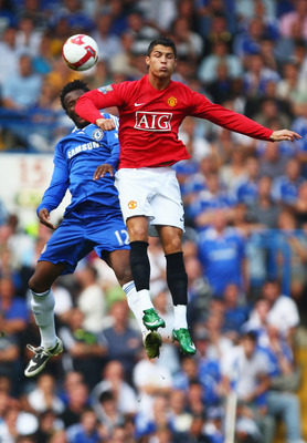 LONDON - SEPTEMBER 21:  Cristiano Ronaldo of Manchester United jumps with John Obi Mikel of Chelsea during the Barclays Premier League match between Chelsea and Manchester United at Stamford Bridge on September 21, 2008 in London, England.  (Photo by Mike