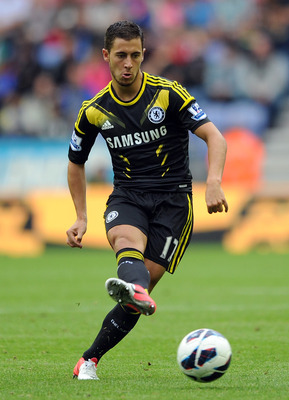 WIGAN, ENGLAND - AUGUST 19:  Eden Hazard of Chelsea in action during the Barclays Premier League match between Wigan Athletic and Chelsea at DW Stadium on August 19, 2012 in Wigan, England.  (Photo by Chris Brunskill/Getty Images)