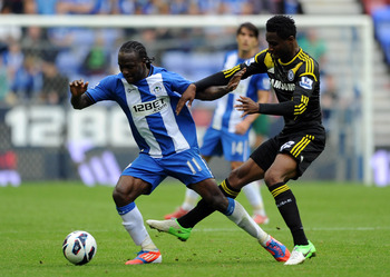 WIGAN, ENGLAND - AUGUST 19:  John Obi Mikel (R) of Chelsea in action with Victor Moses of Wigan Athletic during the Barclays Premier League match between Wigan Athletic and Chelsea at DW Stadium on August 19, 2012 in Wigan, England.  (Photo by Chris Bruns