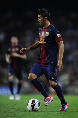 BARCELONA, SPAIN - AUGUST 20:  David Villa of FC Barcelona runs with the ball during the Joan Gamper Trophy friendly match between FC Barcelona and Sampdoria at Camp Nou on August 20, 2012 in Barcelona, Spain.  (Photo by David Ramos/Getty Images)