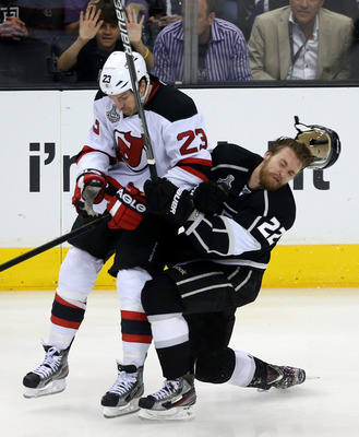 New Jersey Devil David Clarkson hits Los Angeles King Trevor Lewis.