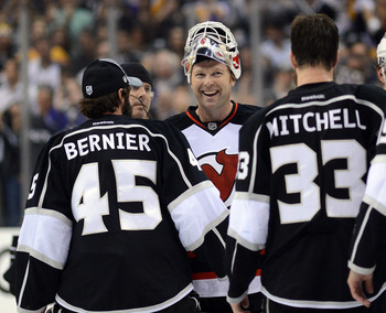 New Jersey Devil Martin Brodeur is so tough he takes on two guys at once.