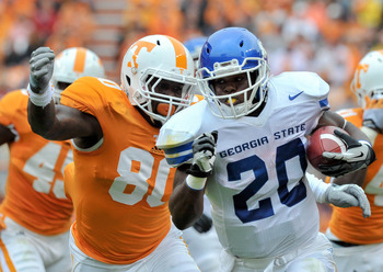 Sep 8, 2012; Knoxville, TN, USA; Georgia State Panthers running back Donald Russell (20) runs the ball against Tennessee Volunteers defensive lineman Corey Miller (80) during the first quarter at Neyland Stadium. Mandatory Credit: Jim Brown-US PRESSWIRE